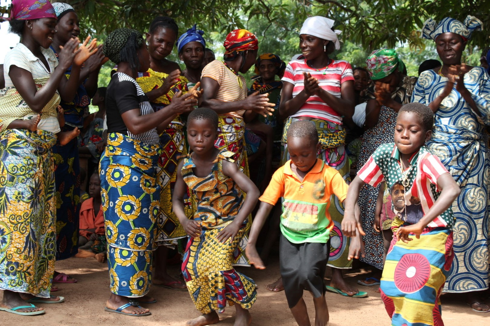 Traditionally dressed women and children dancing in Africa