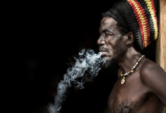 Namibian man blowing smoke