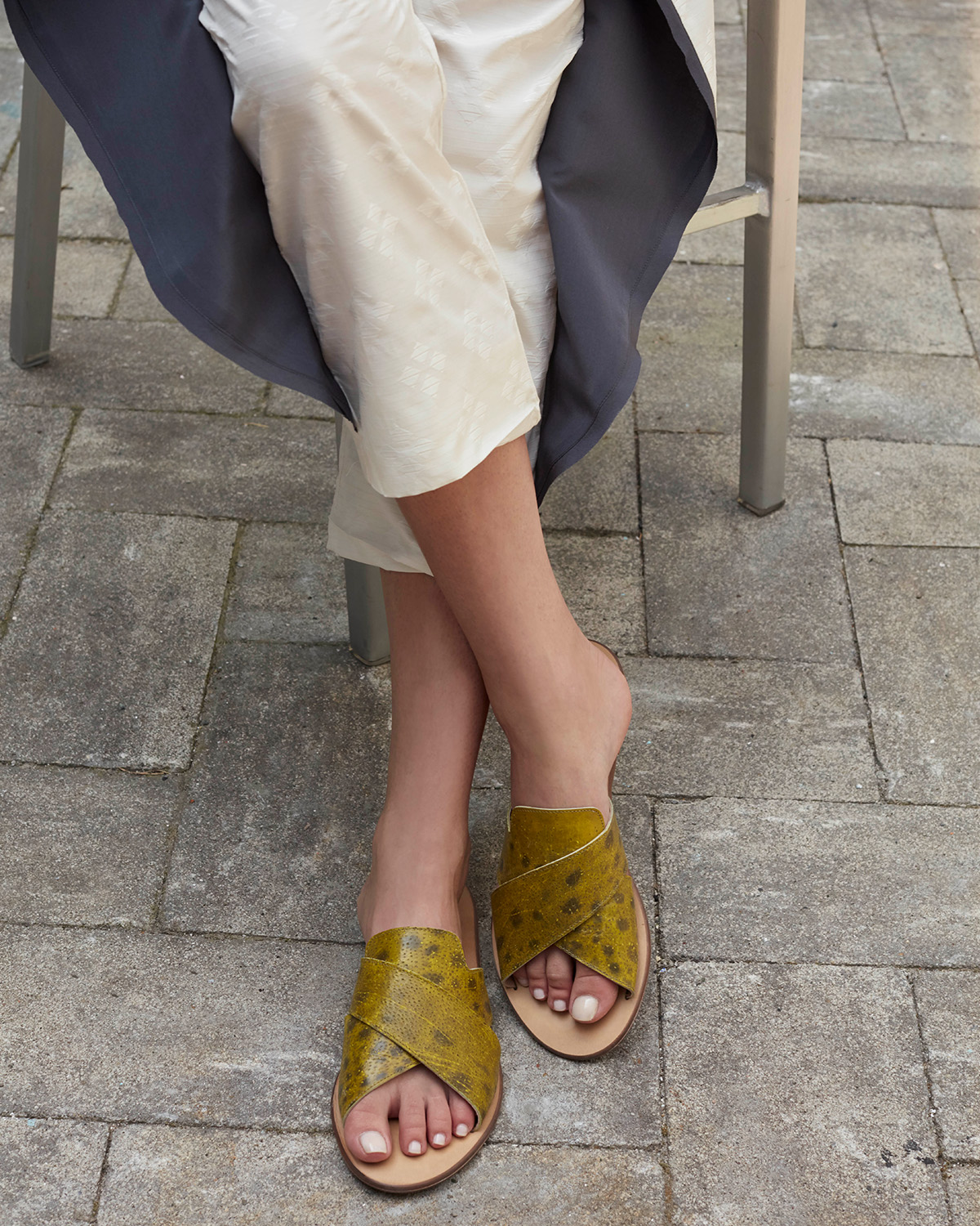 Bav Tailor wearing featured product sandals