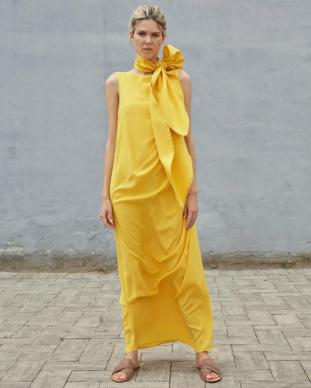 Bav Tailor wearing yellow Shakti dress