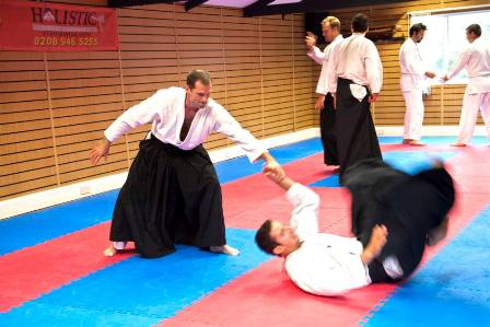 Aikido Class Students Practice Breaking Falls