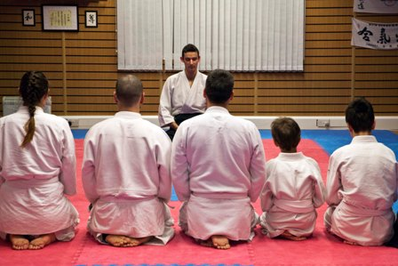 Aikido Students Pay Respects to the Dojo and Sensei Before Class Commences