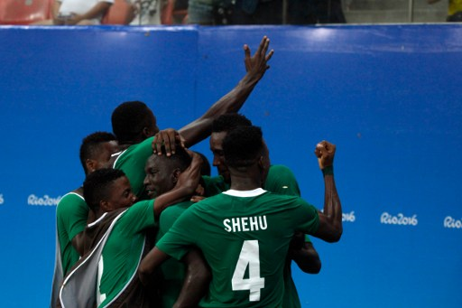 Nigeria's player Oghenekaro Etebo (8) celebrates his fourth goal during the Rio 2016 Olympic Games men's First Round Group B football match Nigeria vs Japan, at the Amazonia Arena in Manaus on August 4, 2016.