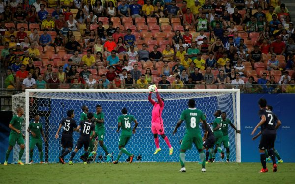 Nigeria's goalkeeper Daniel grabs the ball during the Rio 2016 Olympic Games men's First Round Group B football match Nigeria vs Japan, at the Amazonia Arena in Manaus on August 4, 2016. / AFP PHOTO / RAPHAEL ALVES