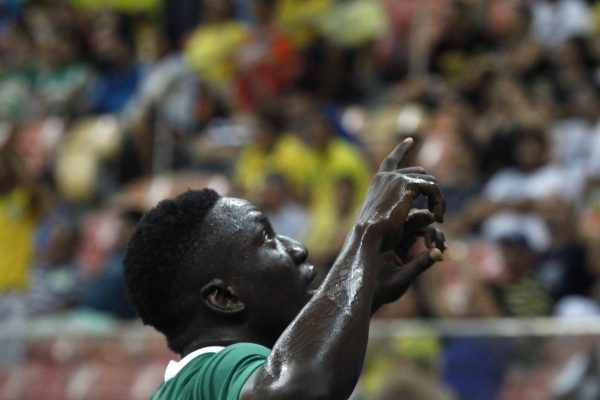 Nigeria's player Oghenekaro Etebo (8) celebrates his fourth goal during the Rio 2016 Olympic Games men's First Round Group B football match Nigeria vs Japan, at the Amazonia Arena in Manaus on August 4, 2016. / AFP PHOTO / RAPHAEL ALVES