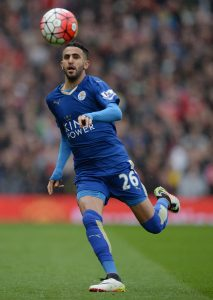 """(FILES) This file photo taken on May 01, 2016 shows Leicester City's Algerian midfielder Riyad Mahrez controlling the ball during the English Premier League football match between Manchester United and Leicester City at Old Trafford in Manchester, north west England. Mahrez, one of the stars of Leicester City's unlikely Premier League title triumph last season, has hinted that only """"two or three"""" clubs could tempt him to leave the English champions. Algerian international Mahrez, who was named player of the year in England by his fellow professionals last season after playing a crucial role in Claudio Ranieri's side's success, has been linked with a big-money move away in the summer. Arsenal, who travel to Leicester this weekend, have been credited with a strong interest in Mahrez but the Foxes are desperate to keep hold of the player. / AFP PHOTO / OLI SCARFF"""
