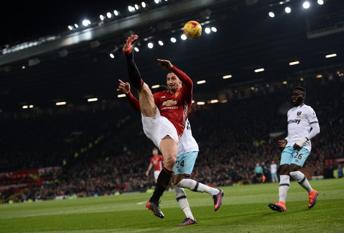 Manchester United's Swedish striker Zlatan Ibrahimovic crosses the ball during the EFL (English Football League) Cup quarter-final football match between Manchester United and West Ham United at Old Trafford in Manchester.