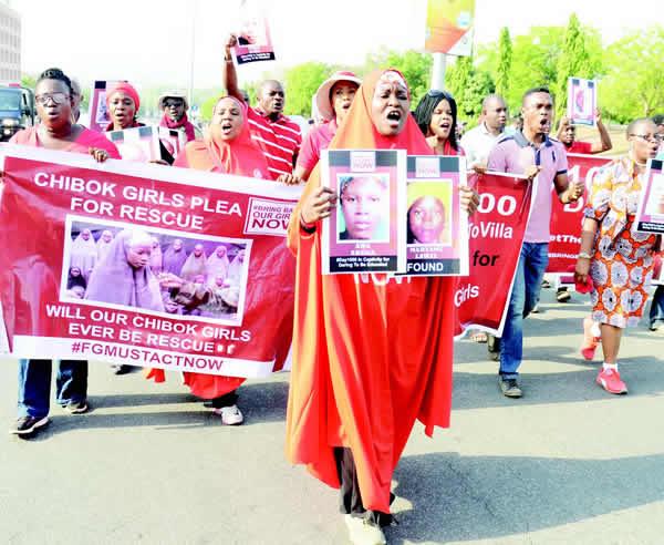 Showdown as Chibok parents insist on meeting Buhari, Osinbajo