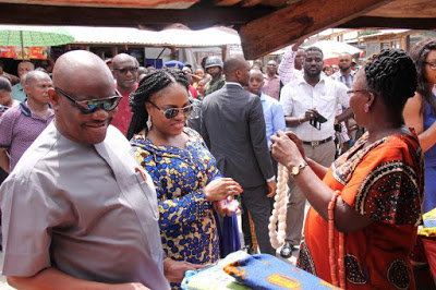 PHOTOS: Crowds flock as Gov Wike, wife shop in PH market