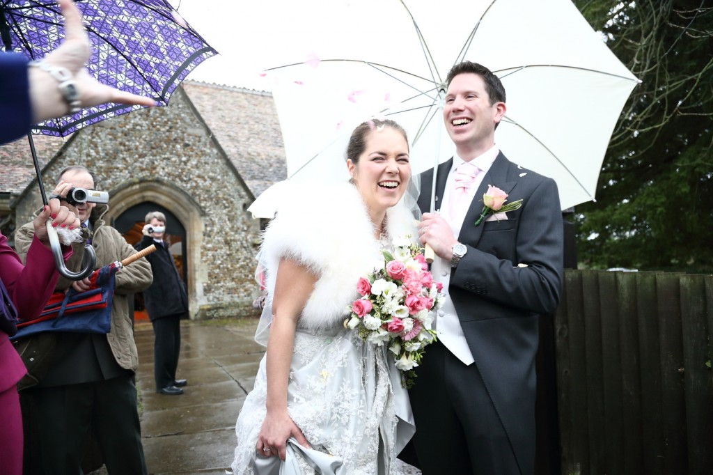 wedding umbreally cambridge laughing photograph