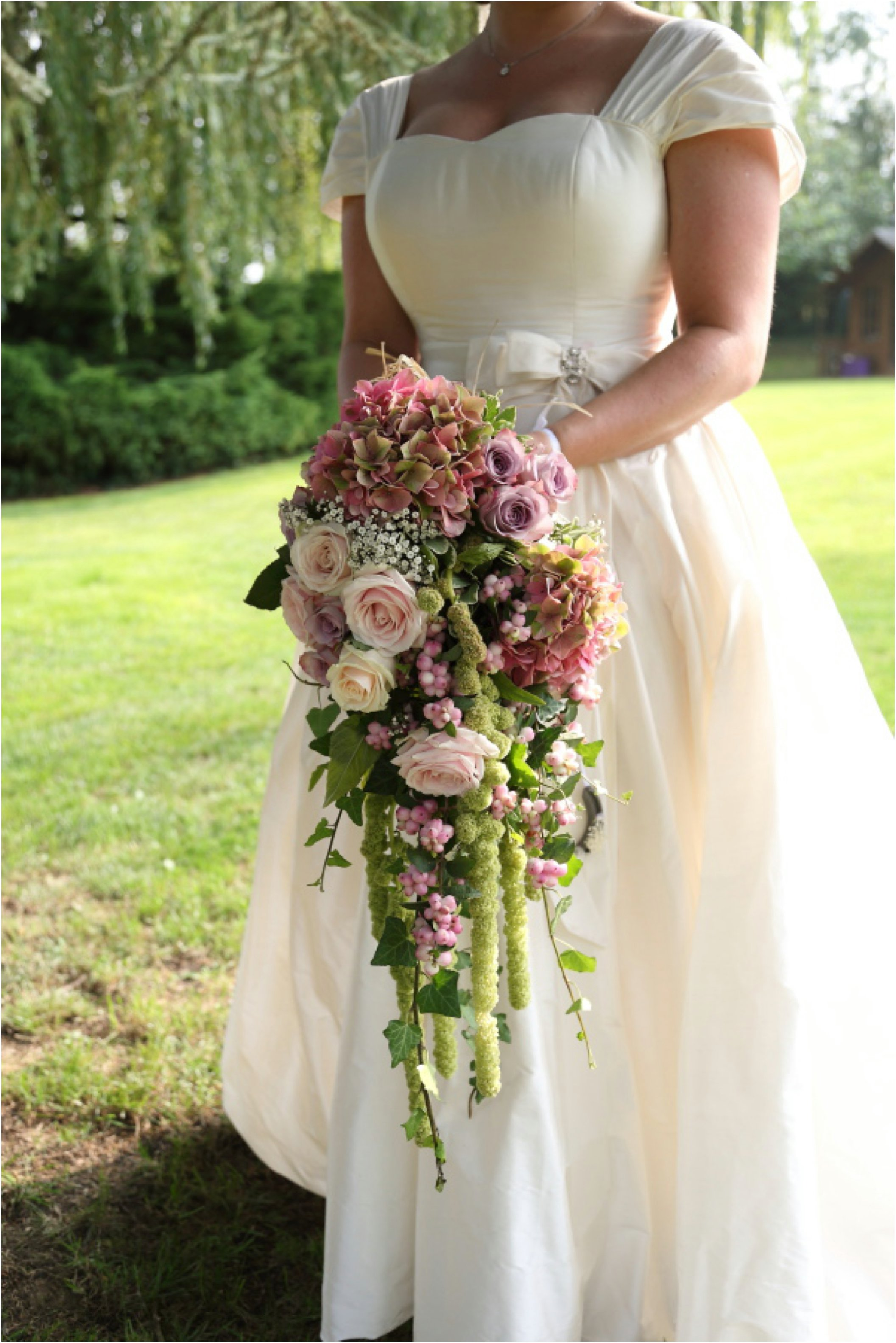 beautiful waterfall bouquet at essex wedding - click through for more images