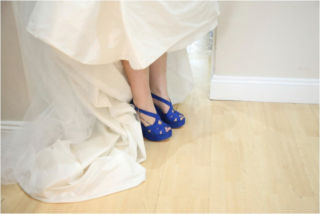 fun wedding phtoography of essex bride in blue shoes