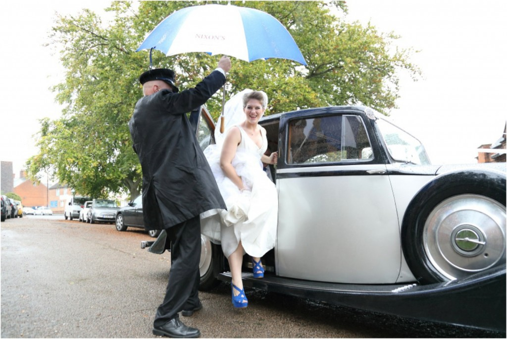 blue umbrella and blue shoes at quirky essex wedding
