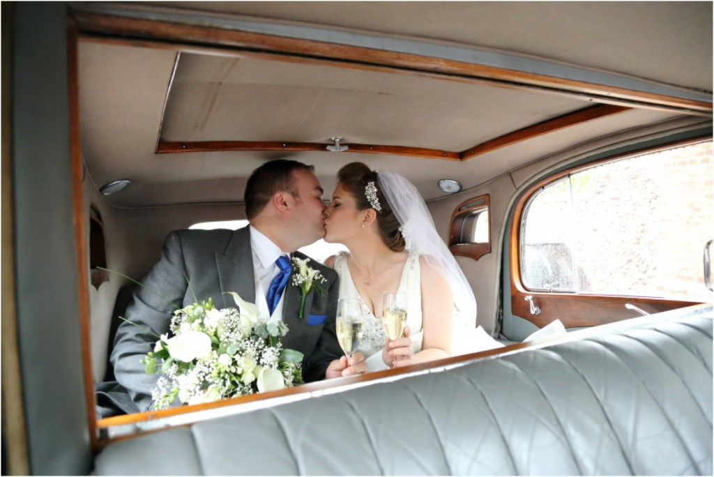 kiss in the car at essex wedding