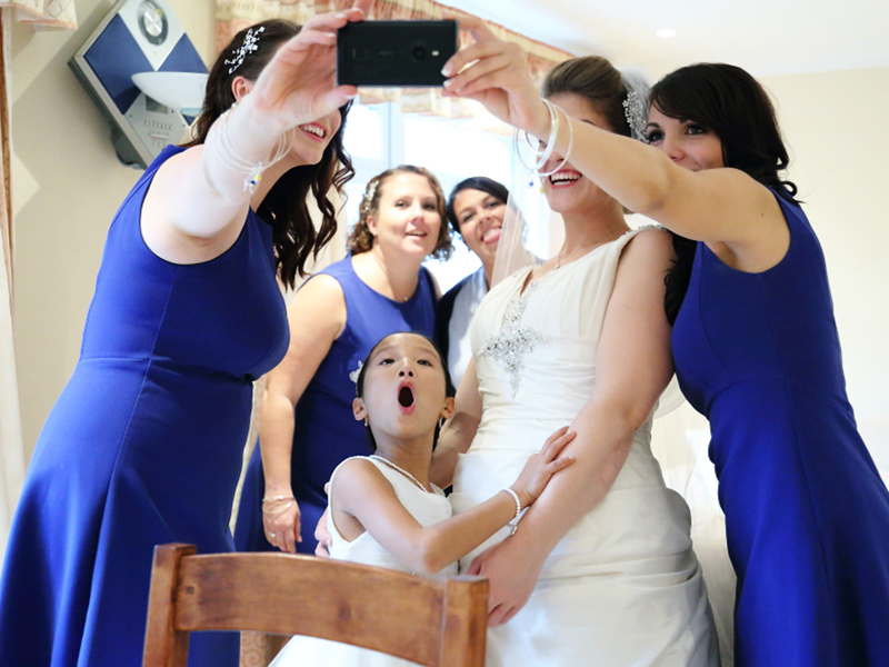 Wedding selfie with bride and bridesmaids at fun Essex wedding