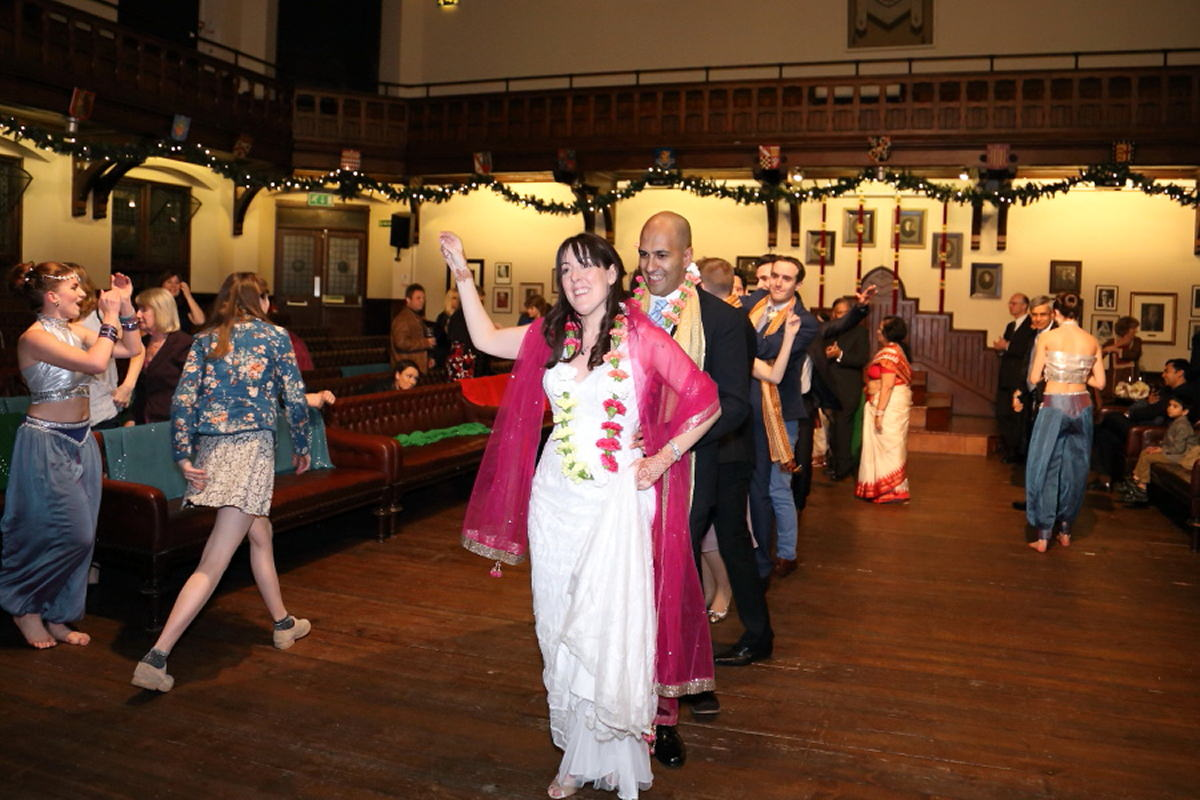 bride and groom dancing to the dance floor to indian song