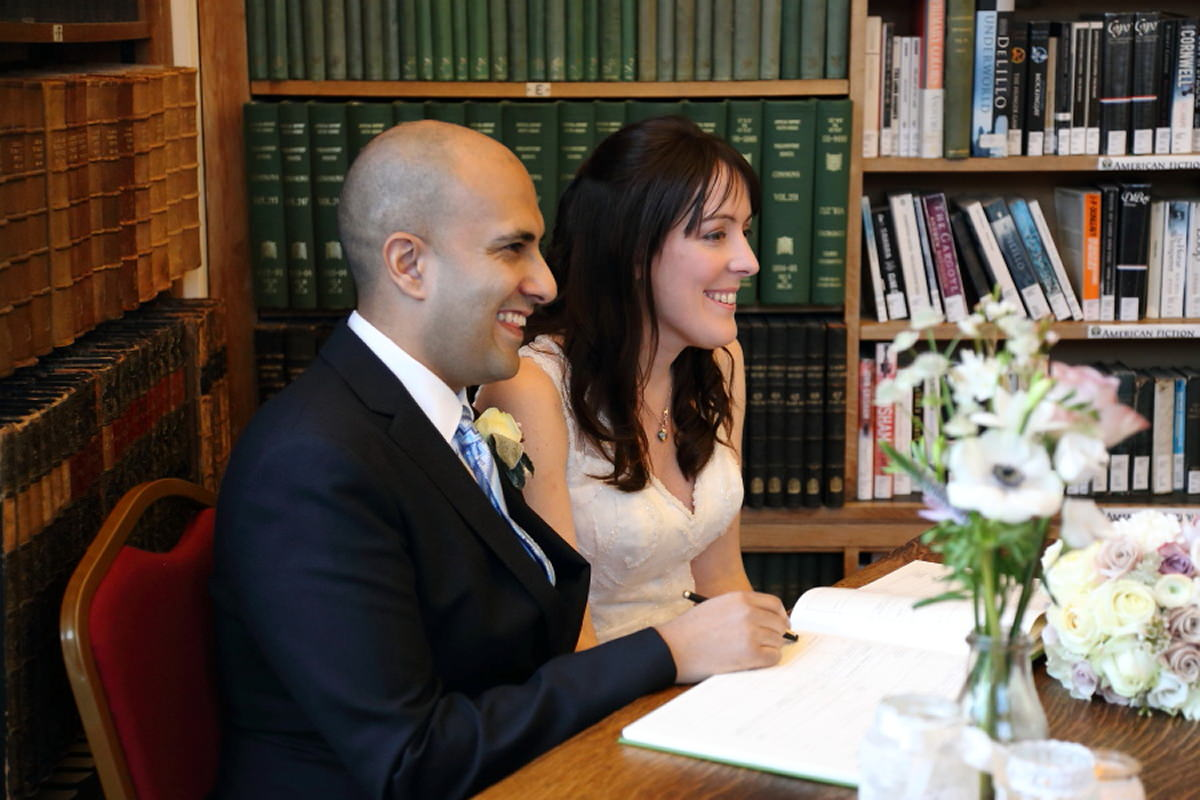 signing the register at cambridge union society wedding