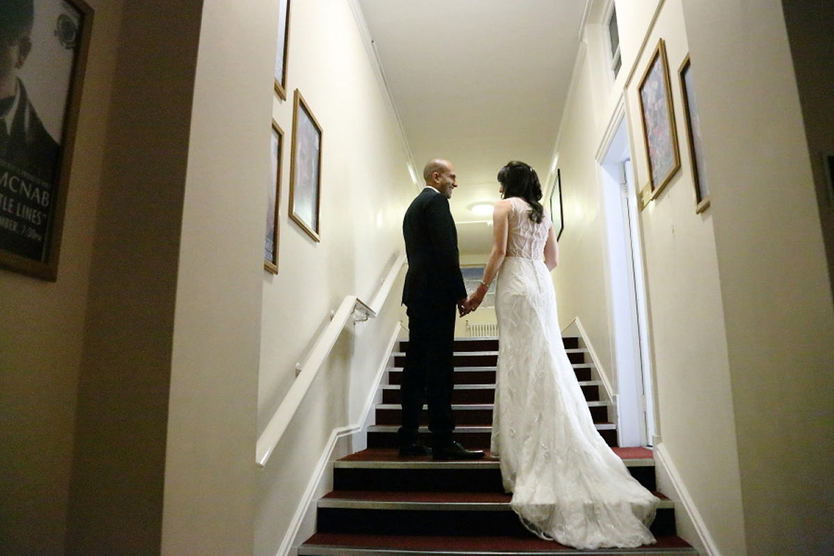 wedding couple standing on the stairs at cambridge union society