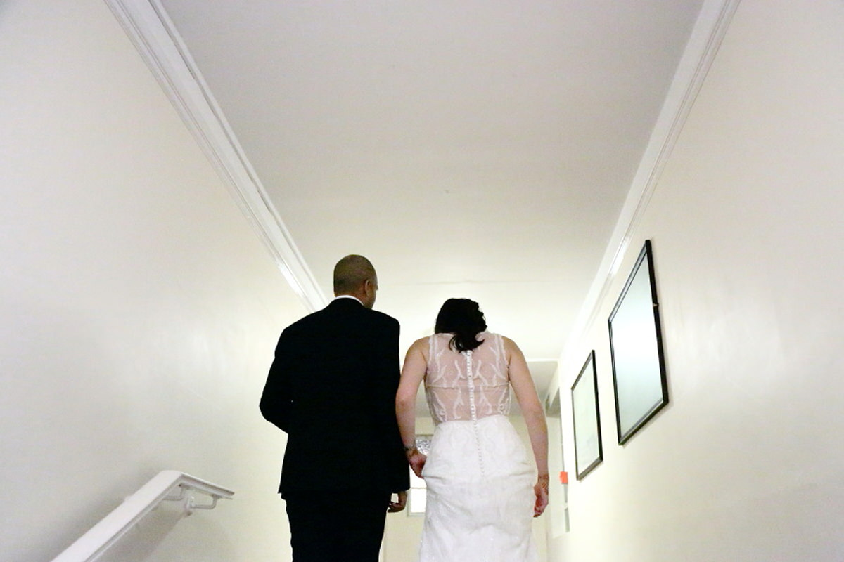 walking up the stairs at cambridge union society wedding