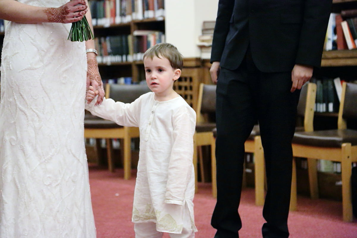 paige boy waiting patiently at cambridge wedding