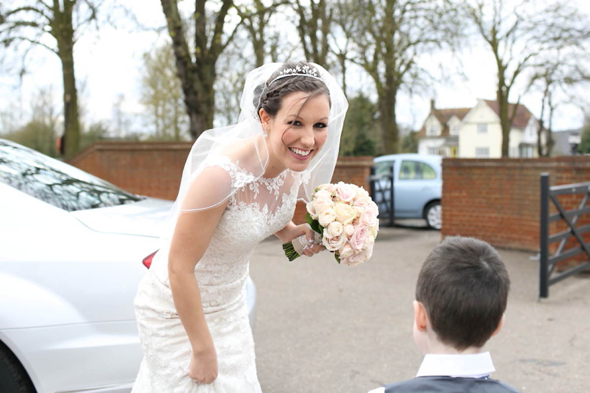 happy bride at fun wedding at channels golf club essex
