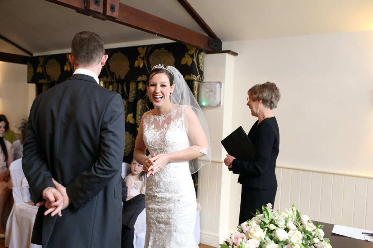 laughing bride at ceremony channels golf club essex