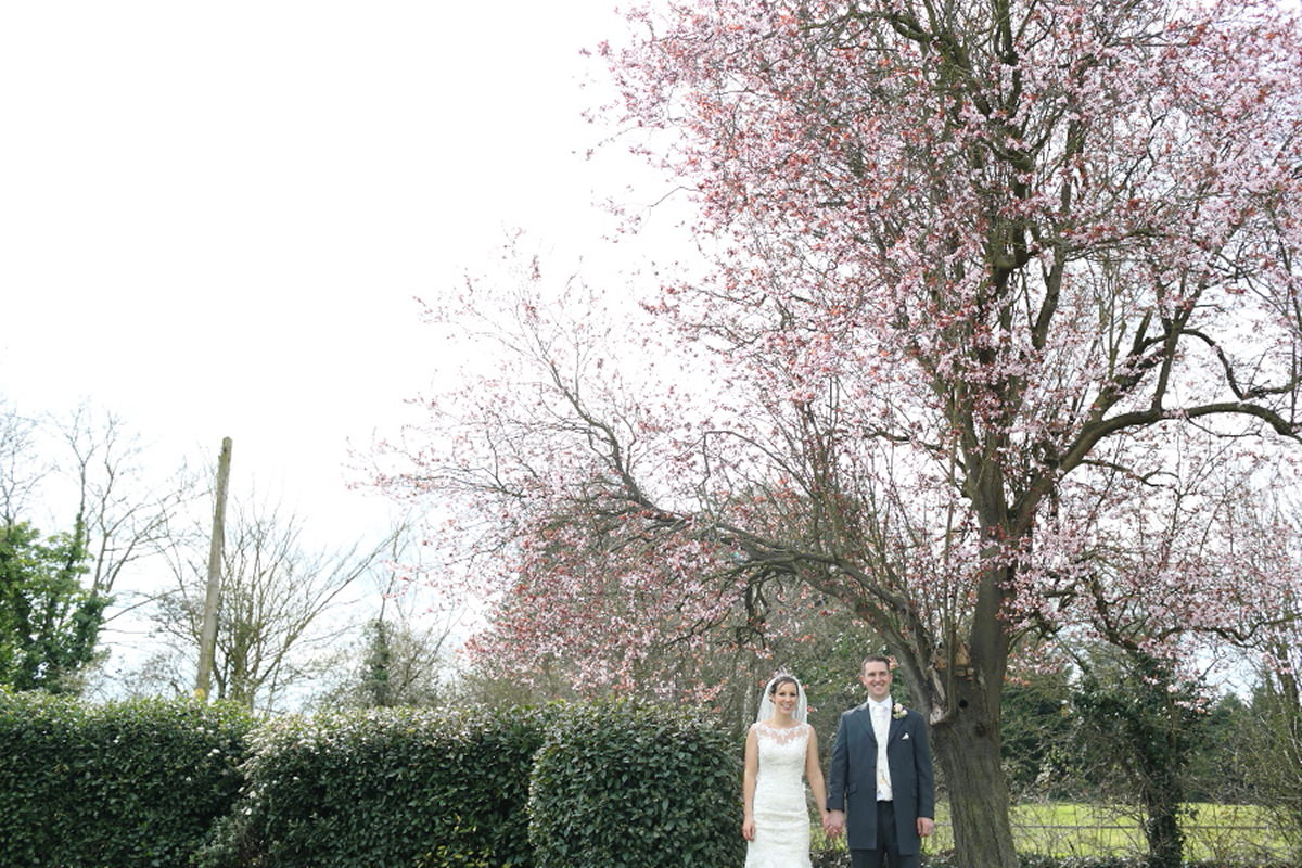 deadpan couples portraiture under cherry blossom tree at channels golf club essex