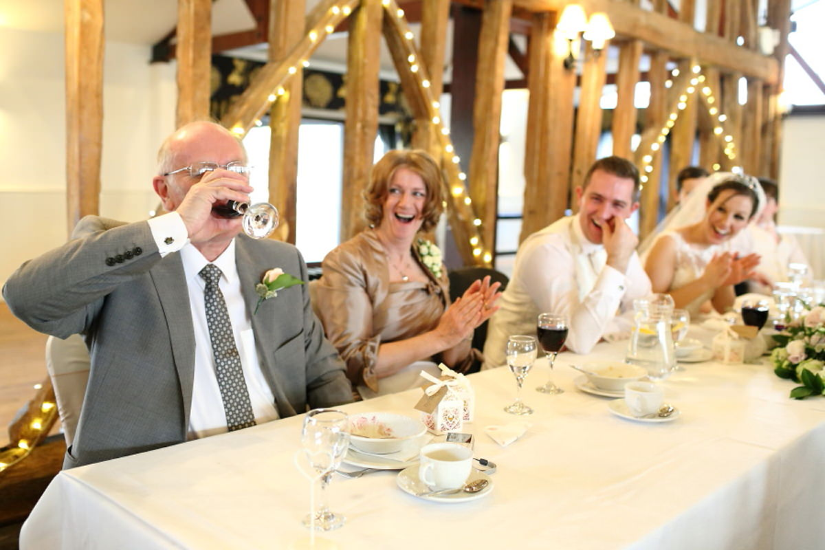 father of the bride downing a drink at channels essex wedding