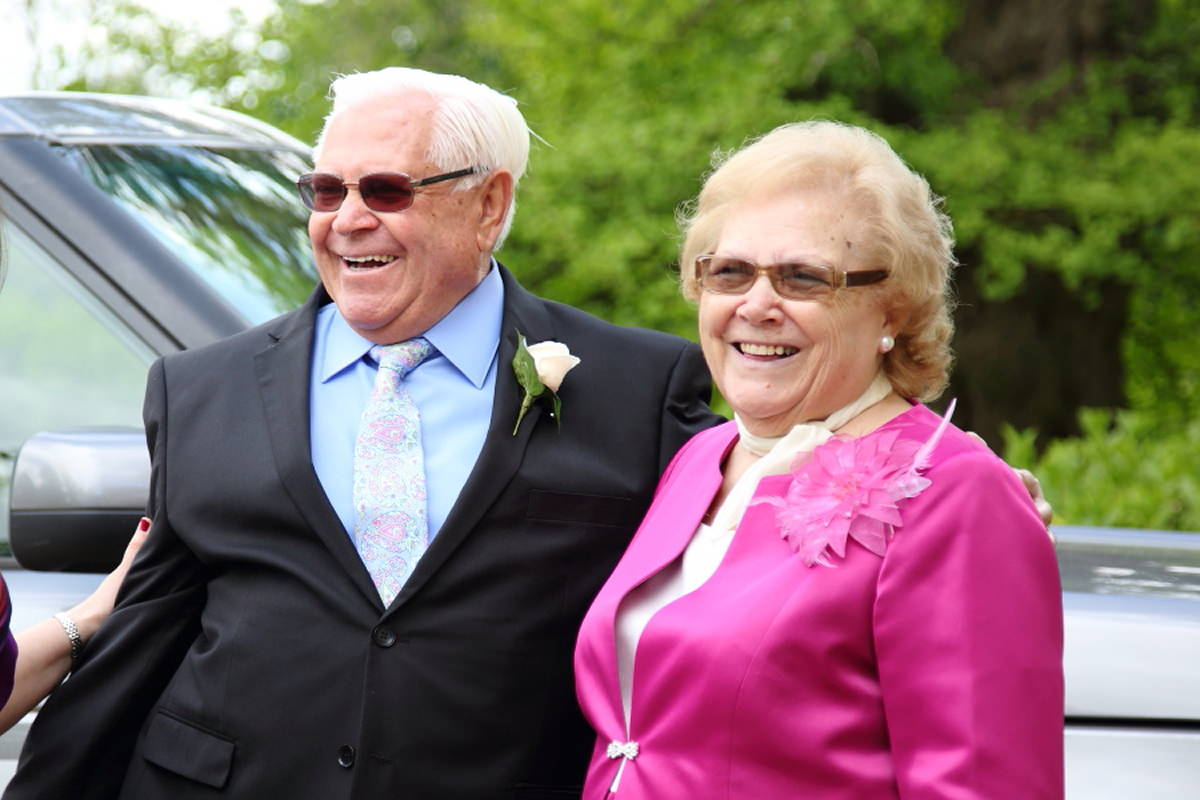 laughing parents at fun Le Talbooth wedding in Essex