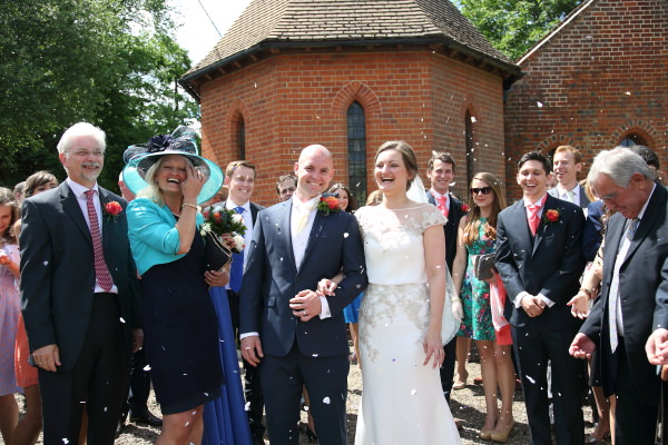 confettii and laughter at sewards end church wedding