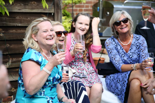 laughter at relaxed barn wedding in saffron walden