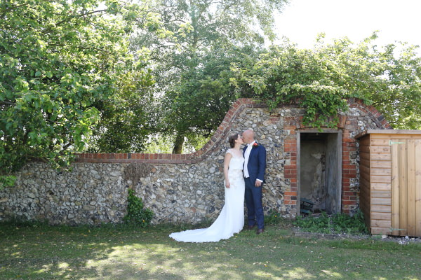 stone wall and natural creative honest wedding photography in saffron walden