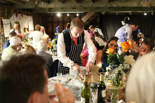 carving the food at relaxed saffron walden wedding with natural photography