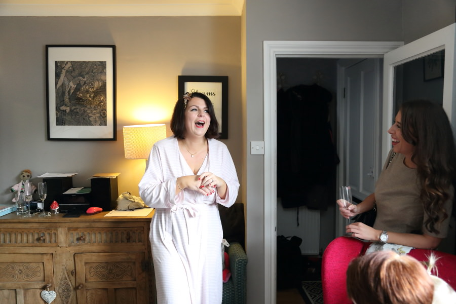 laughing bride getting ready at home, bishops stortford