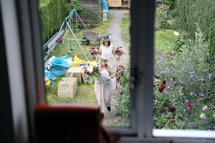 bridesmaids bringing in the flowers at bishops stortford wedding
