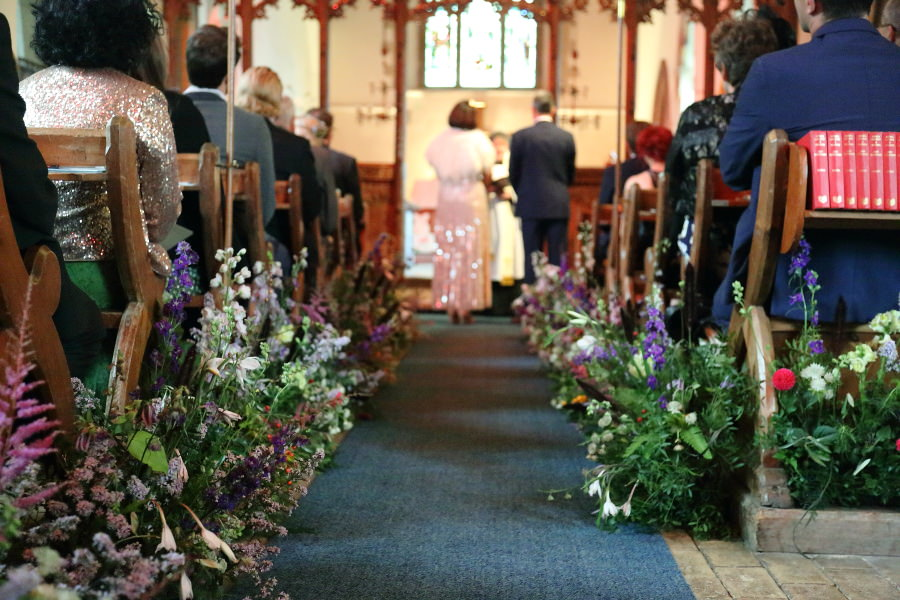 flower wlak way down the aisle at manuden church, essex. Violets and velvet florist.