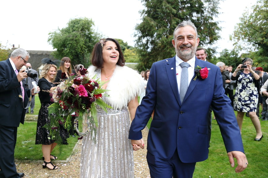 confettii and walking, happy couple after the ceremony, manuden church