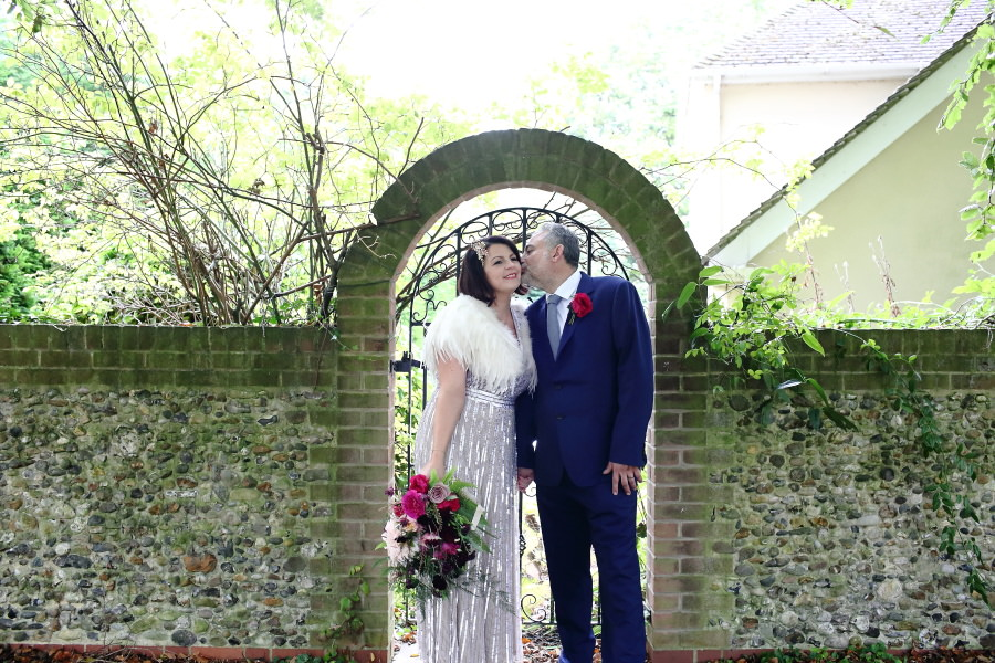 old arch way at manuden church, with quirky couple