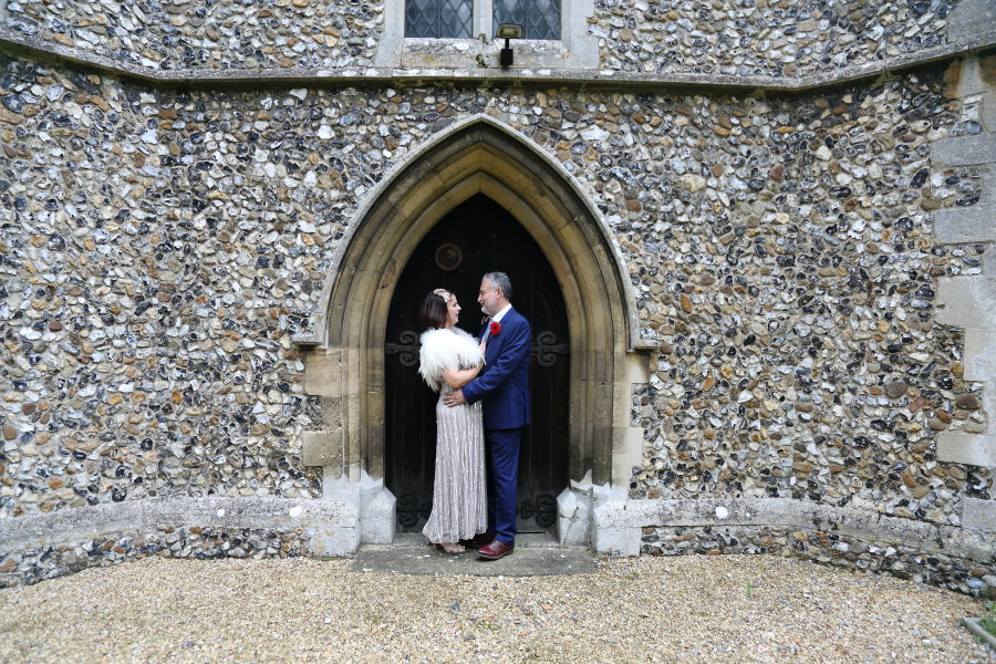 couple in the beautiful doorway at manuden church wedding