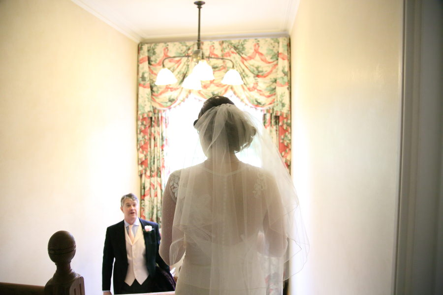 heading down the stairs, father of bride, bury st edmunds wedding