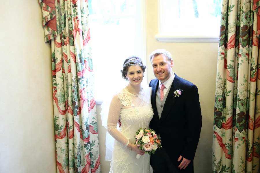 couples photo on stairs at country house wedding, bury st edmunds