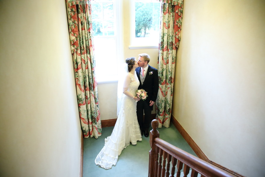 couples portrait on stairs at notown wedding, suffolk