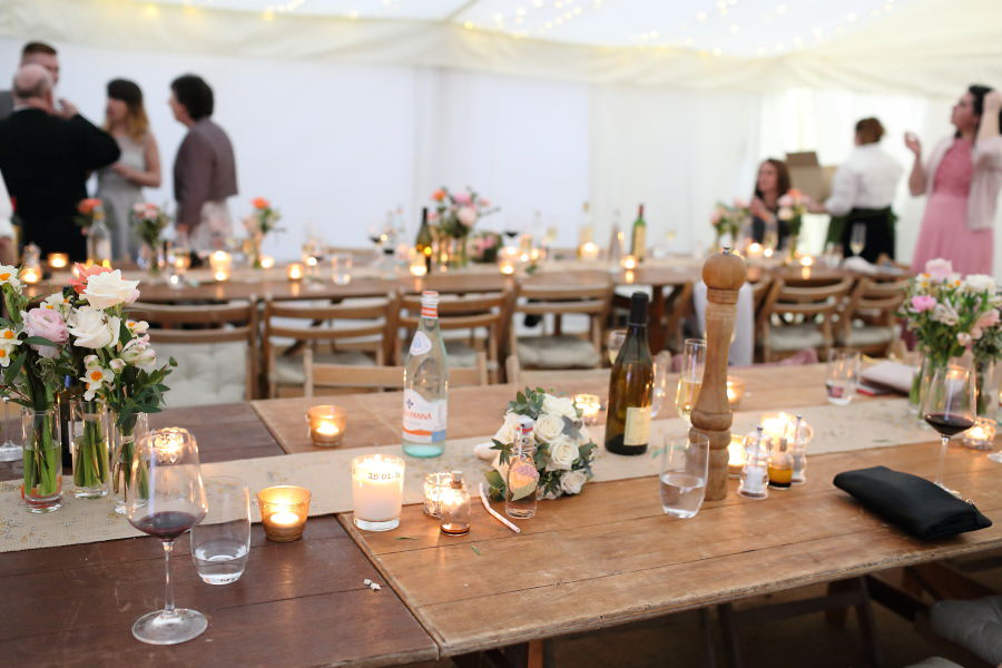 pretty tressle tables, flowers and candles at Bury St Edmunds wedding