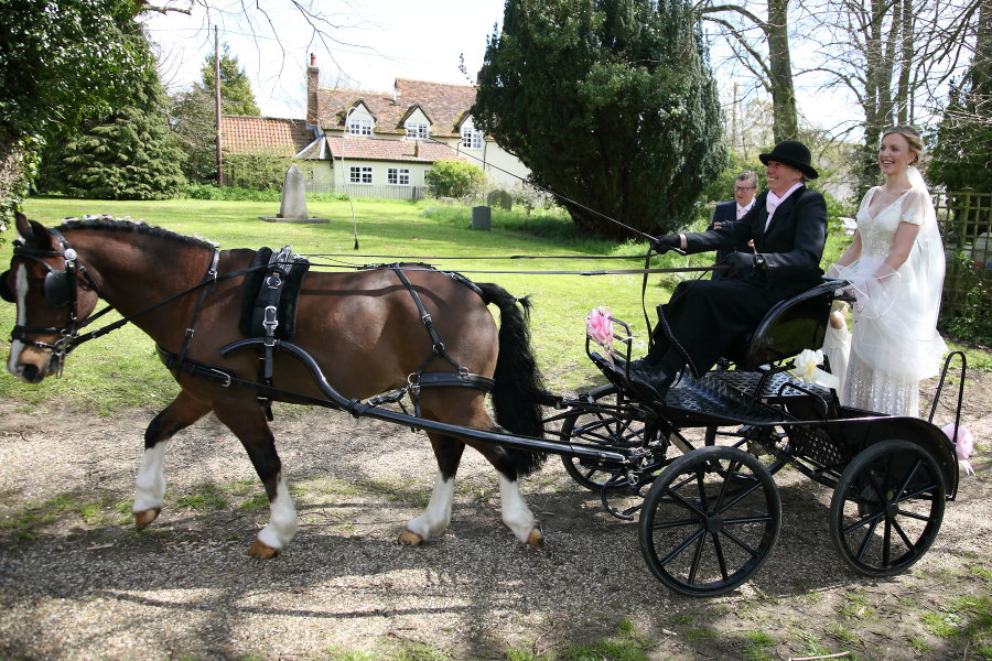 bride arriving on horse and cart