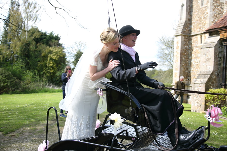 bride arriving at essex church on horse and cart