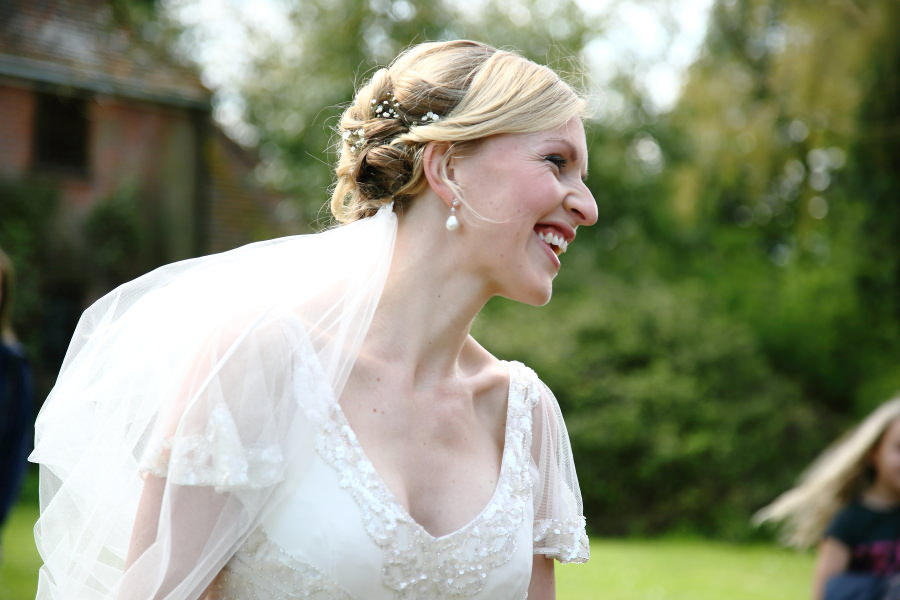bride arriving at church on horse and cart, fun wedding photography