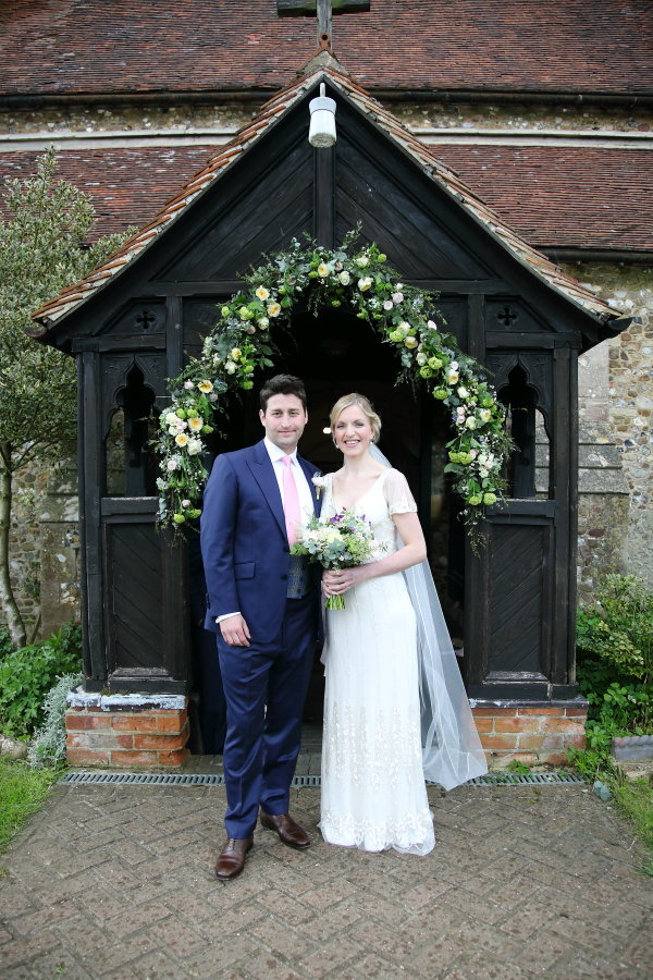 flower arch at the church and jenny packham dress, essex village wedding
