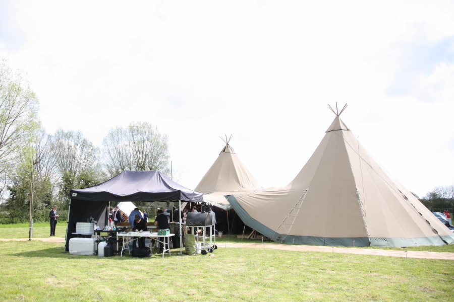 amazing giant tipi and pizzas for wedding breakfast at fun essex village wedding