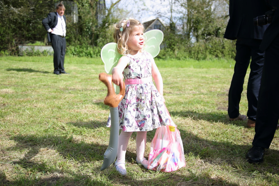 fairly wings and blow up swords for children to play with at essex tipi wedding