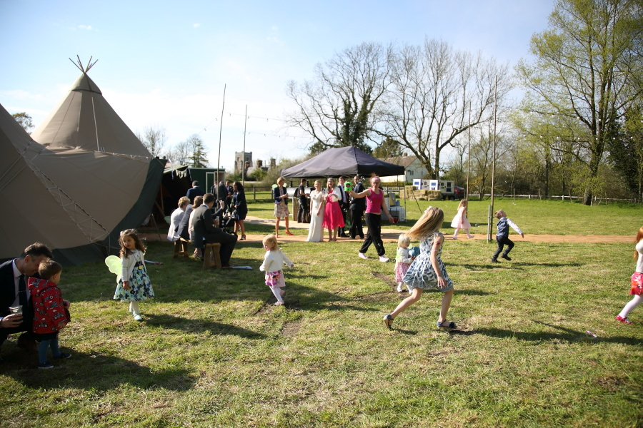 playing outside the tipi at essex fun wedding